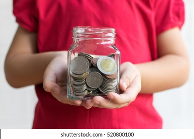 Money in children hands. Business and finance concept