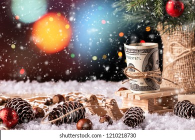 Money Christmas Gift with wooden sled. Christmas and New Year concept