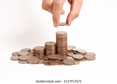 Money coin stack growing business in a hand