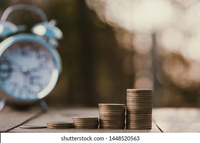 Money coin stack growing graph with sun light bokeh background,investment concept.Business Finance and Save Money concept