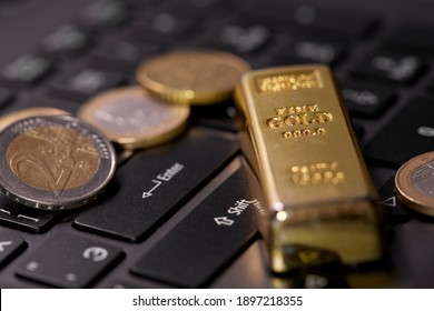 money coins on laptop computer