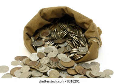 money coins pour out from bag isolated on white