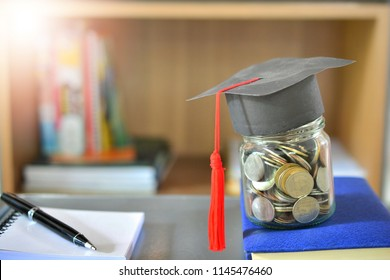 money coins saving in bottle glass with hat graduation model on book for concept investment finance education and scholarships