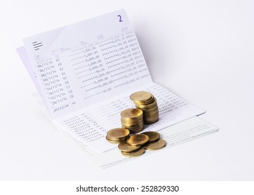 Money Coins stack and book bank saving plan for loan concept