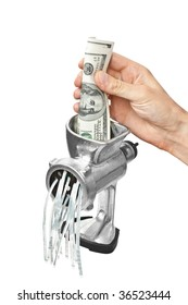 Money concept. Dollars are milled in a meat grinder isolated