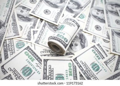 money concept. roll of dollars against many others.