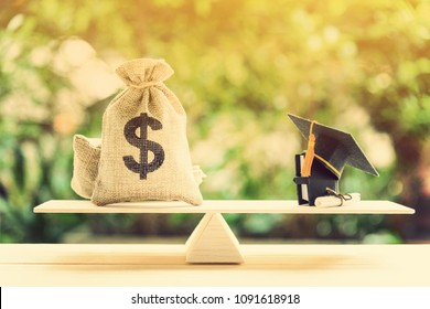 Money cost saving for goal and success in school, education concept : US dollar bills / cash in hessian bags, a black graduation cap or hat, a certificate / diploma and a book on simple balance scale.