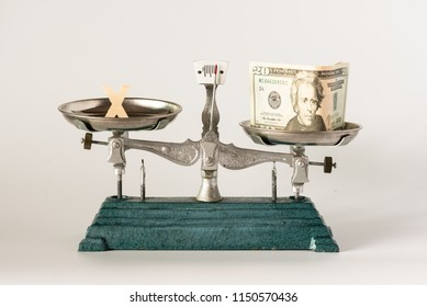 Money and cross or wrong mark on pan weight scale on white background.Corruption concept.