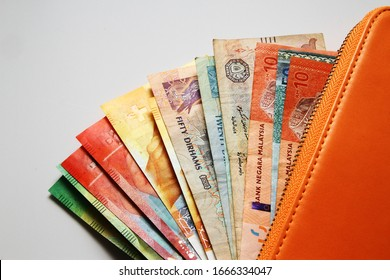 Money, currency from all over the world on wallet or purse