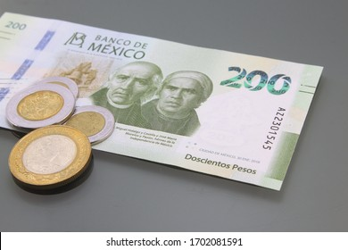 México Money, Currency of México, Pesos, bill of two hundred and coins, close-up on dark background. Cash money