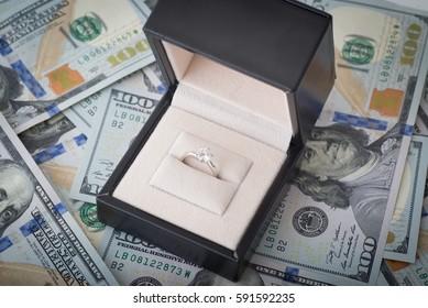 money and diamond ring