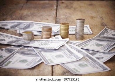 money dollar, bank note and coin in still life on wood table