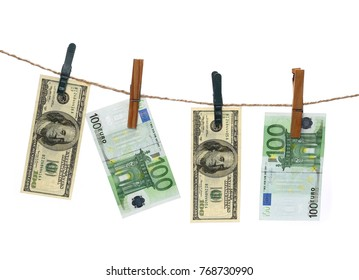 Money, dollars and euros laundering on string with clothespins with clipping path