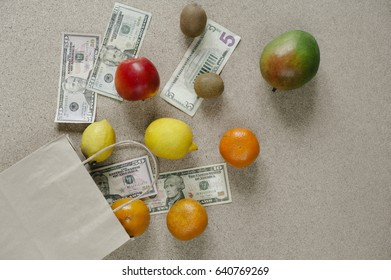 money dollars. package of fruit . gift. In the supermarket and buy products and fruits and vegetables