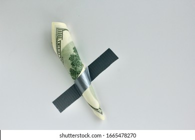 Money duct taped to the wall.Conceptual photo. Background for sticker, t-shirt screen printing. Copy space.