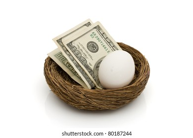 Money with an egg in a nest isolated on white, Saving for your retirement