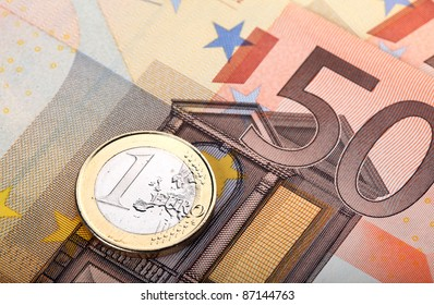 Money: euro banknote and coin