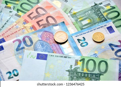Money euro coins and banknotes on the table.