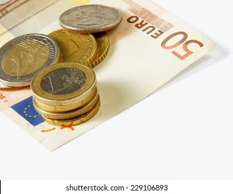 Money: euro coins and bills close up isolated on white background