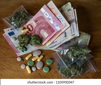 money euros and hryvnia illegal. concept of the crime of drug trafficking. Tablets, pills and cannabis lie on cash.