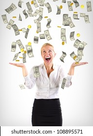 Money falling on a business woman