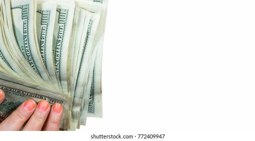 Money in a female hand close up on a white background.
