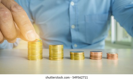 Money, Financial, Business Growth concept, Business man's hand put money coins to stack of coins