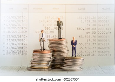 Money, Financial, Business Growth concept, Businessmen miniature figures stand on top of stack of coins in front of book bank