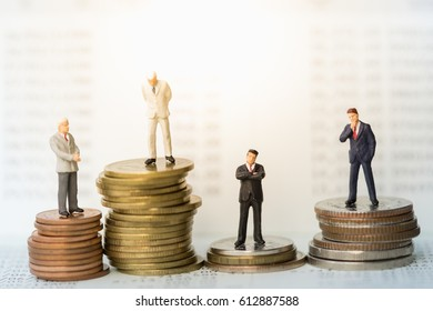 Money, Financial, Business Growth concept, Miniature figures businessmen stand on top of stack of coins in front of book bank account