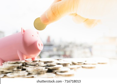 Money, Financial, Business Growth concept. Man's hand put money coins to piggy bank.