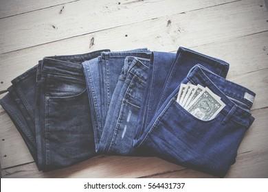 Money financial concept. money in pocket. Cash in jeans pocket on wood background.