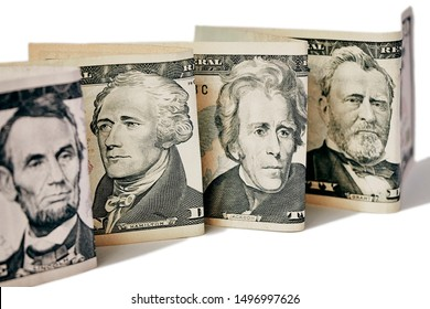 Money, four banknotes standing in a line line one after another, portraits of the presidents of the USA depicted on them, with faces of people, concept of honesty of money, close-up.