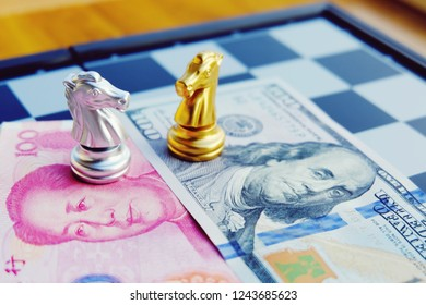 Money game. Chess game. Referring two big countries's conflict. Trade war. Chinese and US bank note under Silver and Golden horse that confront each other. International finance concept.