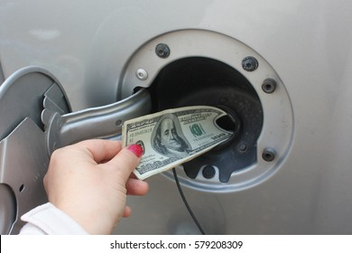 Money Getting Dumped Into Gas Tank