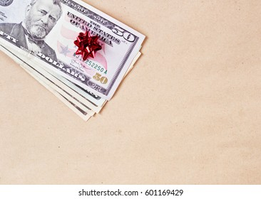 Money gift with dollars on brown paper background