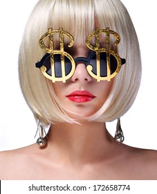 Money Girl. Fashion Blonde Model with Gold Sunglasses shaped in Dollar Sign. Glamorous young woman with short bob hairstyle isolated on white. Finance Concept.