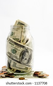 money in the glass jar -- life savings in a bank
