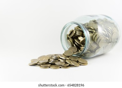 Money in a glass jar on a white background