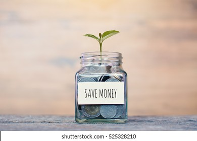 "Money in a glass jar with ""save money"" word. concept siphons money,vintage tone and sunlight"