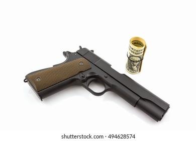 Money with gun on white background.