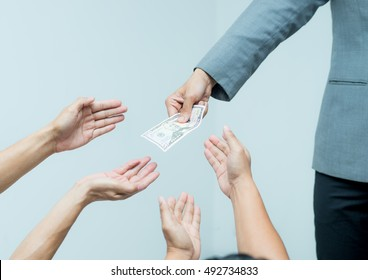 Money from hand in business suit to another hand,Man in business suit pay or give money for something,Close-up Of Person Hand Giving Money To Other Hand, hand to hand money pass