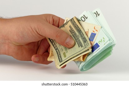 Money in the hand isolated on white background