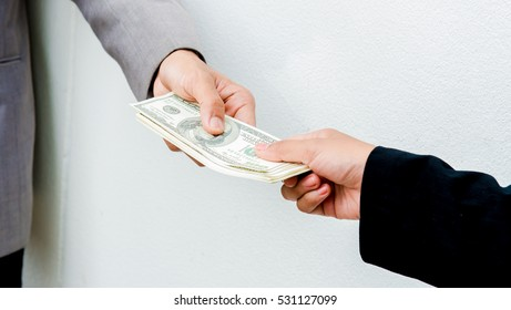 Money from  hand to you,Close-up of Person hand giving money To other hand