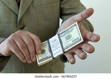 Money in the hands of business man on a white background.