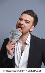 Money in the hands of a cheerful businessman