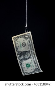 money hanging on a fish hook as bait - concept image - risk, profit, loss, investment, etc.