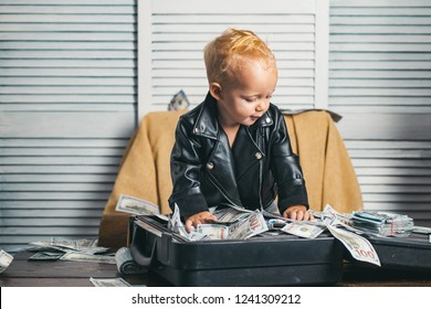 Money has no smell. Small child do business accounting in startup company. Little entrepreneur work in office. Boy child with money case. Little boy count money in cash. Startup business costs.