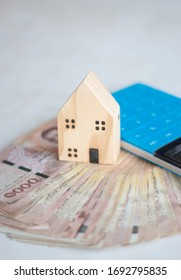 Money with house model, savings plans for housing