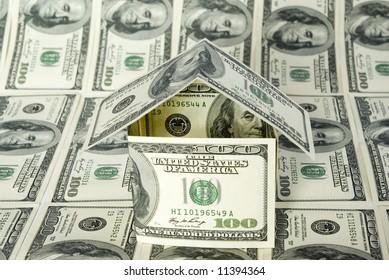 Money house on dollars background