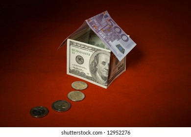 Money house on red with coins